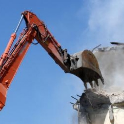 Digger demolishes building in site clearance operation